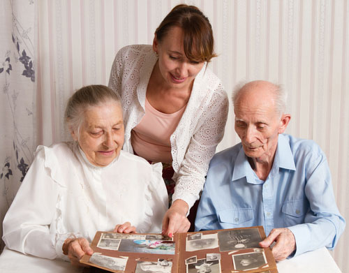 Senior Man Woman with their Caregiver at Home